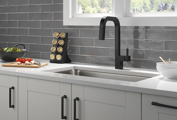 Gray subway tile kitchen with matte black pull-down faucet