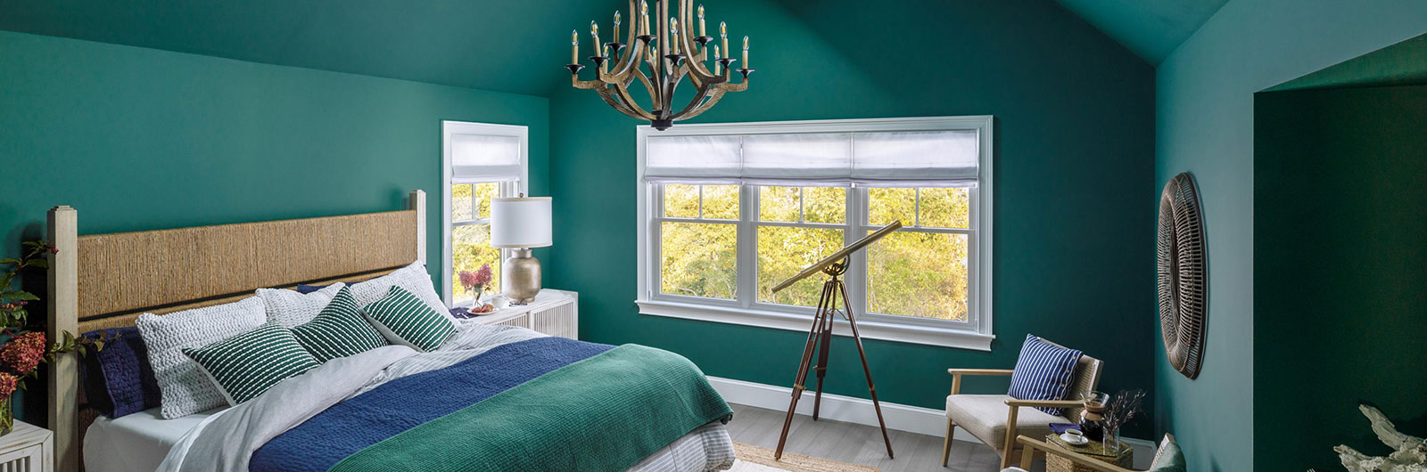Dream Home 2021 bedroom with dark, emerald green walls showing bed and scenic view out window