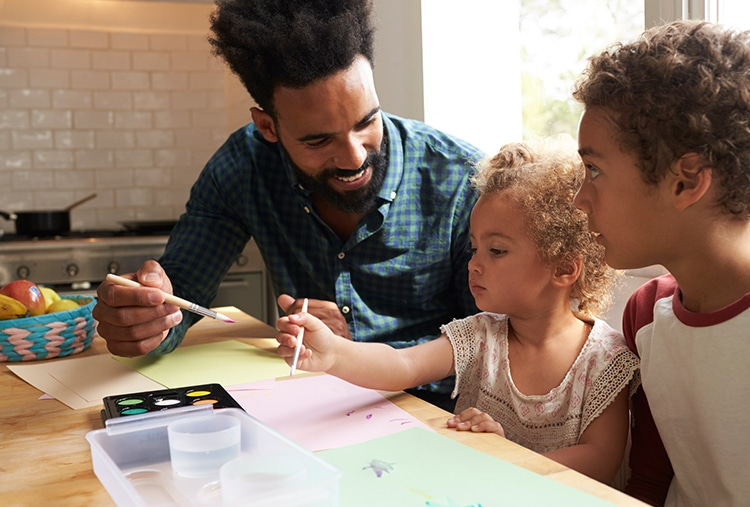 Father painting with children